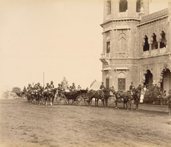 H.H., Mr.Fraser & Capt.Gabb [arriving at the New Palace, Kolhapur, in a carriage].